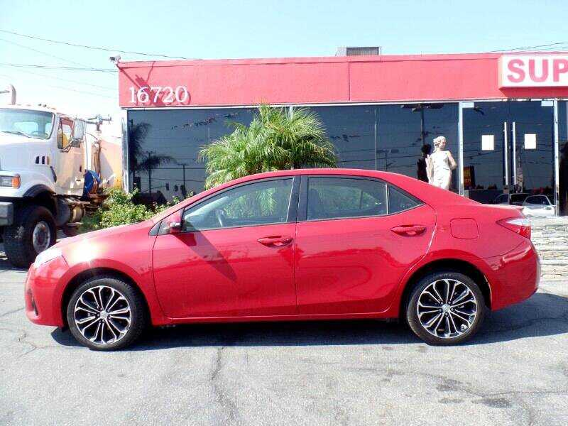 Red sedan on the parking lot